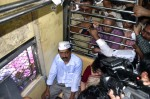 Kejriwal rides auto, train in Mumbai, BJP calls him 'dramebaaz'