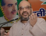 BJP leader Amit Shah addressing media in Lucknow on April 19, 2014. (Photo: IANS)