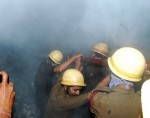 Kolkata: Fire fighters try hard to douse a fire that broke out at a plastic godown in Kasba of Kolkata on March 1, 2015. (Photo: IANS)