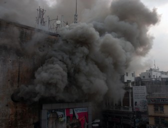 Kolkata: Smoke billows out of a Kolkata Shopping Mall after a fire broke out on April 26, 2015. (Photo: IANS)